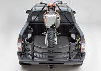 AMP Research - Innovation in Motion - Amp Research BEDXTENDER HD SPORT Black Toyota Hilux 2005-13